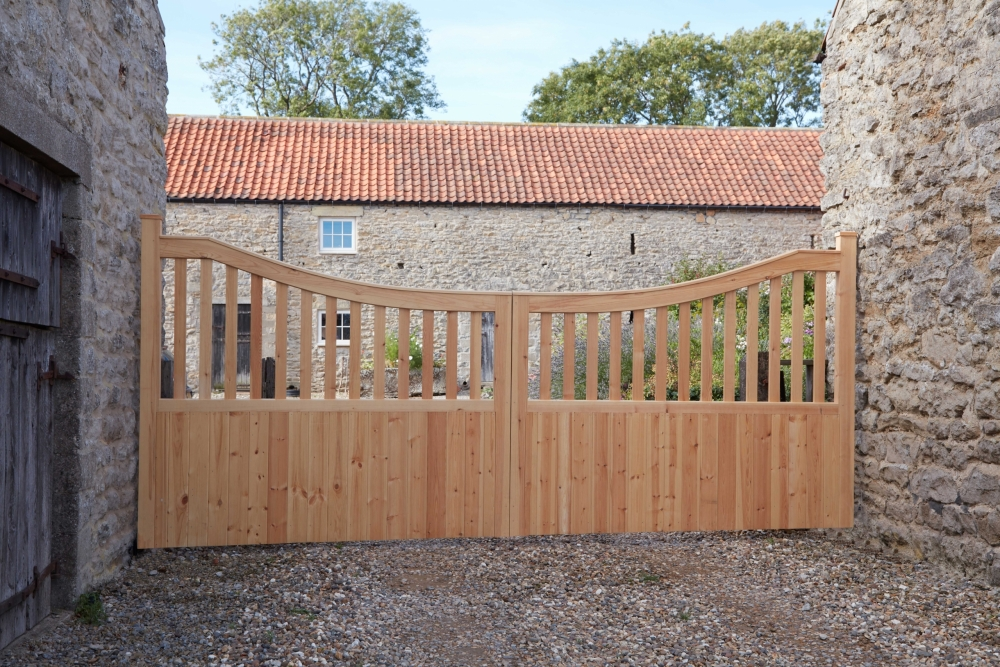 Danby style softwood gates with curved top uprights and solid bottom