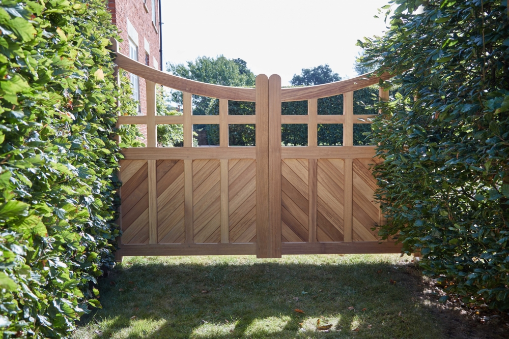 Frith style art deco hardwood iroko gate with chevon boards and chamfered rectangular details