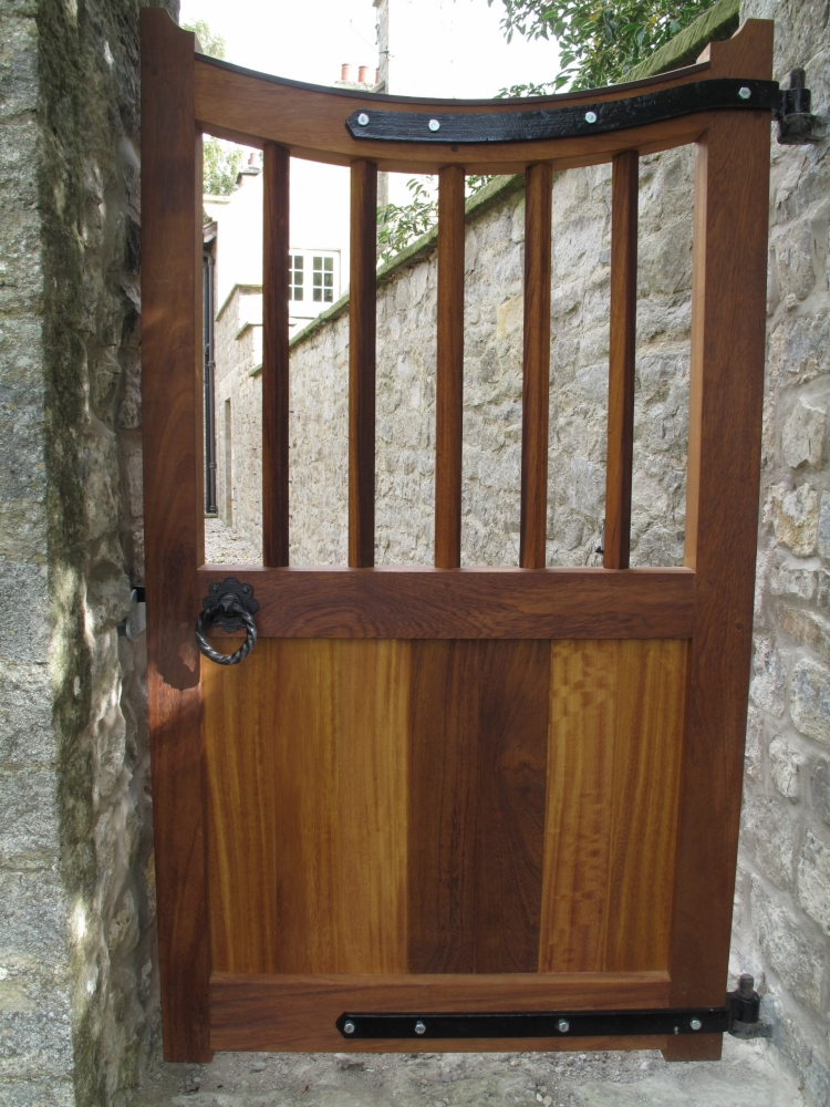 Leighton style hardwood iroko gate with curved top and semi boarded