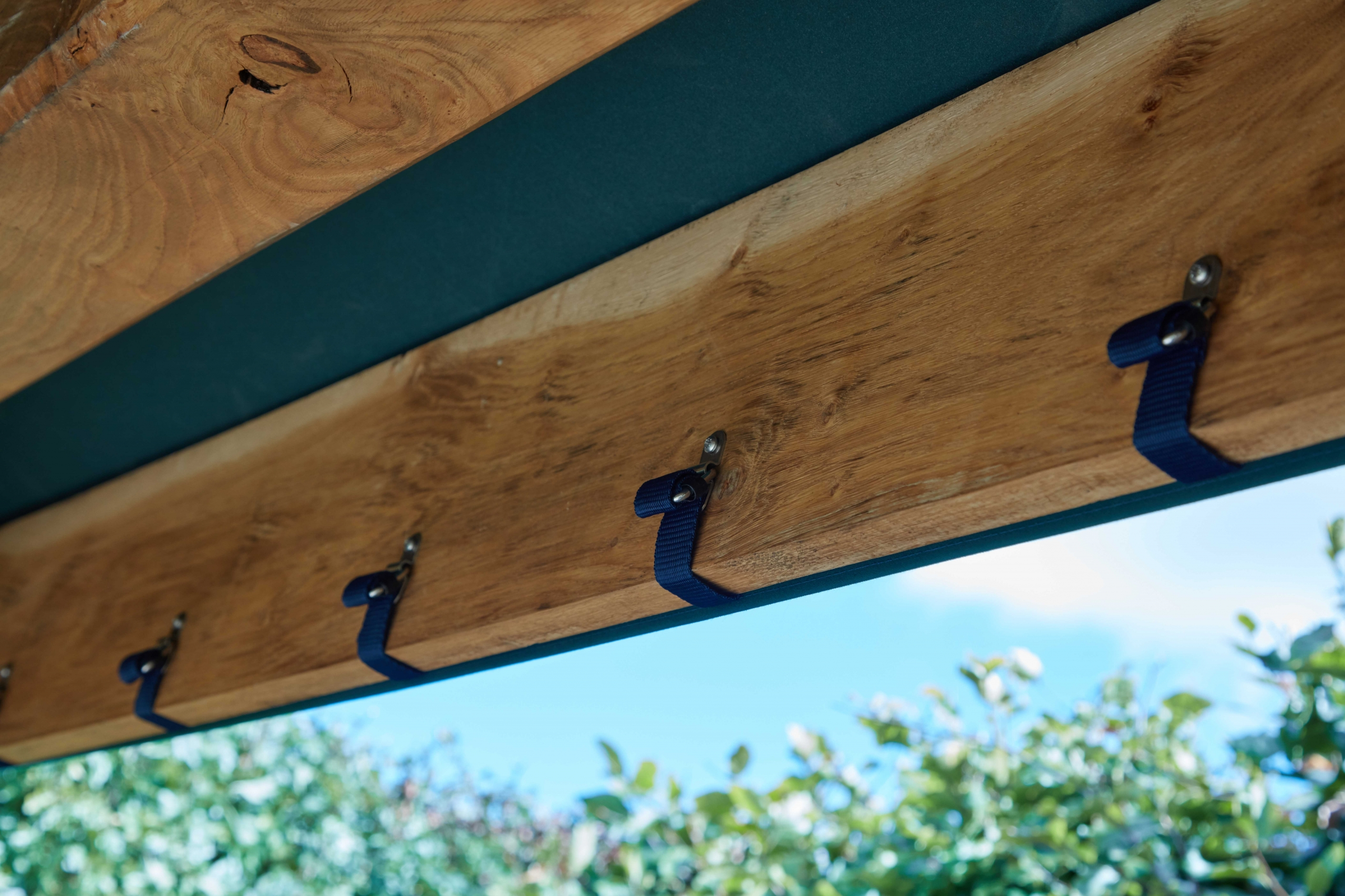 Interior of oak or larch timber framed gazebo showing canvas roof attachments