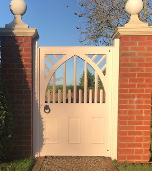 White painted gate with arched top and semi boarded
